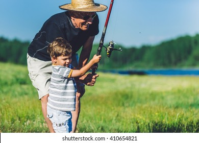 Grandfather and grandson fishing and having fun