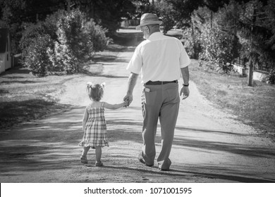 a grandfather with the grandson go on the road
