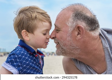 Grandfather and grandson having fun on the beach