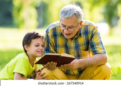 Grandfather and grandson learning about nature