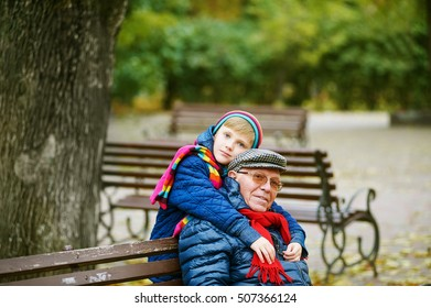 Grandfather and grandson playing in autumn Park . Family values