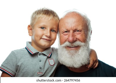 Grandfather and grandson smiling on white background
