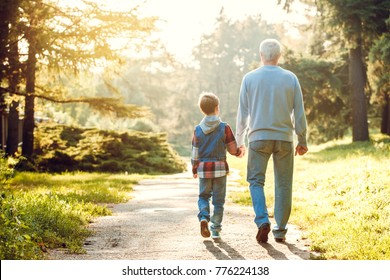 Grandfather and grandson together outdoors family concept