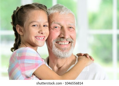 Grandfather with her granddaughter hugging