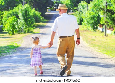 a grandfather with his granddaughter are on the road
