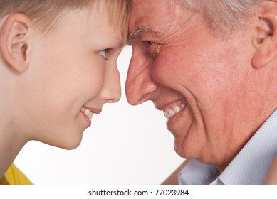 grandfather with his grandson on a  white