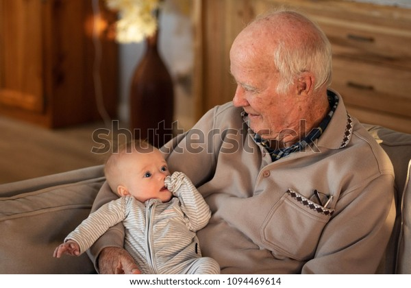 Grandfather Holding Baby