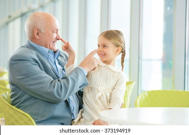 Grandfather meeting his cute granddaughter.