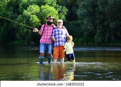 Grandfather with son and grandson having fun in river. Happy fathers day. Grandson with father and grandfather fishing by lake