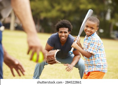 Grandfather With Son And Grandson Playing Baseball
