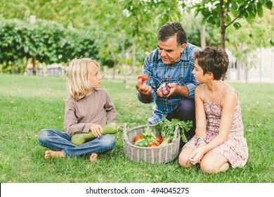 Grandfather Teaching Healthy Eating to Grandchildren