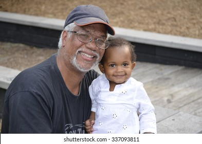 Grandfather and toddler girl at the park