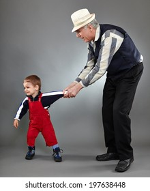 Grandfather trying to discipline his naughty grandson