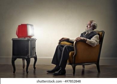Grandfather watching tv