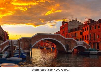 Grandiose sunset on the canal Cannaregio and brigde Ponte dei Tre Archi in Venice, Italy