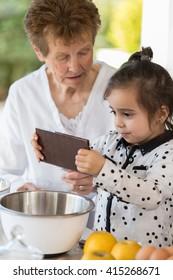 grandma and girl cooking