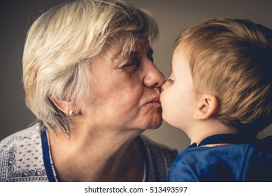 Grandma and Grandchild kissing