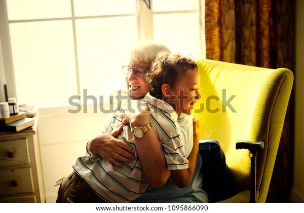 Grandma and grandson in a big hug