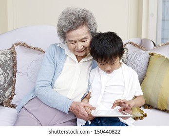 grandma and grandson looking at tablet computer together.