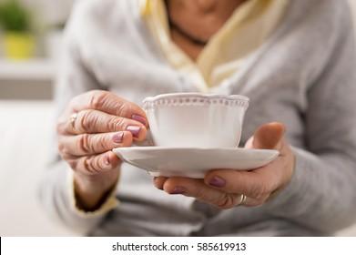 Grandma having a cup of coffee/tea