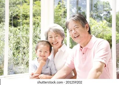 A grandma holding her grandson