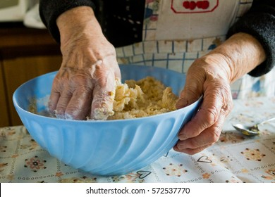 grandma making pasta the old traditional way in her home