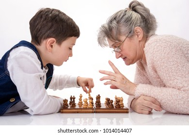 Grandma and nephew face to face playing chess