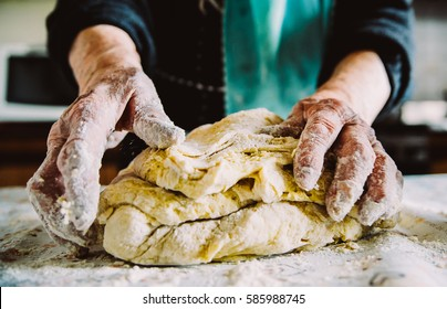 grandma preparing bread and pasta in traditional way