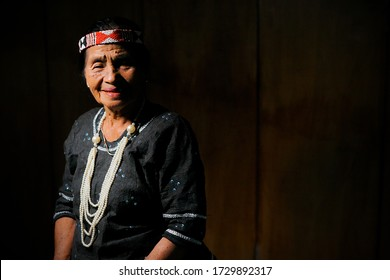 Grandma Tobani Tiku, a bark cloth craftsman is using traditional clothes made of bark cloth and have been made since prehistoric times. Matauwe Village, Sigi Regency. Central Sulawesi. February 2020