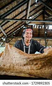 Grandma Tobani Tiku, a craftsman is making leather bark cloth and using traditional cloth. This cloth has been used since prehistoric times. Matauwe Village, Sigi Regency. February 2020