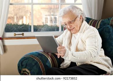 Grandma Using Tablet PC in Living Room