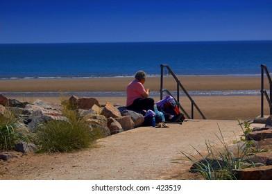 Grandma watching her grandchildren at the beach