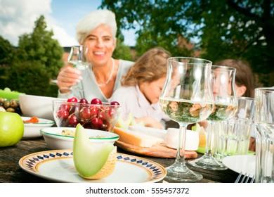 Grandmom And Their Grandchildren Are Having A Picnic