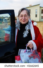 Grandmother with arms full of gifts