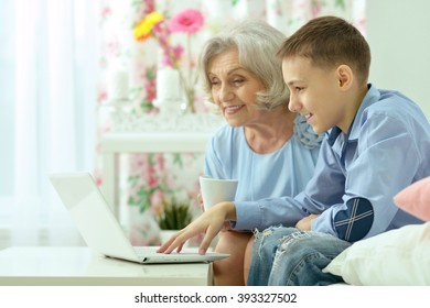 grandmother and boy with laptop