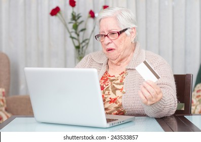 Grandmother buying online with credit card