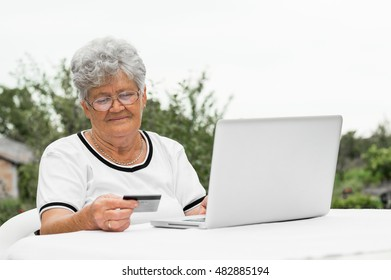 Grandmother buying online with credit card, looking for info
