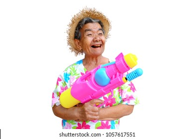 Grandmother cheerful playing water gun Songkran festival isolated on white background. Water festival, Songkran in Thailand. Celebration of Traditional Thailand New Year.