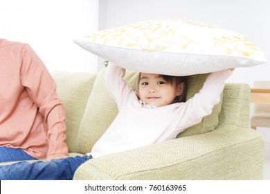 Grandmother and child playing in home