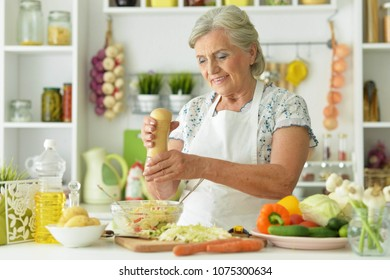 Grandmother cook in the kitchen