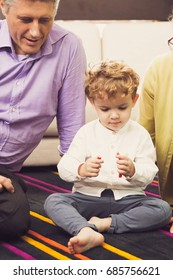 Grandmother, Dad and Little Boy Sitting on Floor