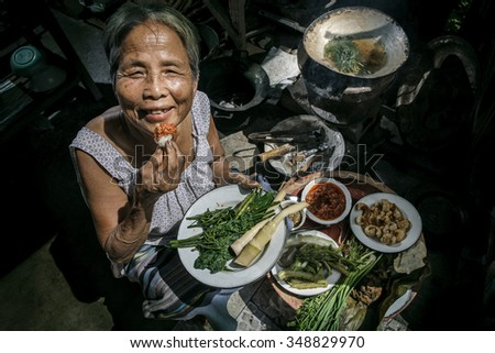 Grandmother Or Eating Organic Food Mother In The Kitchen At Home, Lifestyle  Of Asian Old