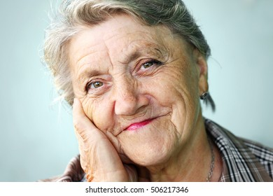 Grandmother face on a grey background