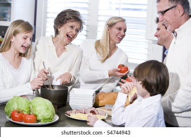 Grandmother with family cooking in kitchen, smiling and laughing together
