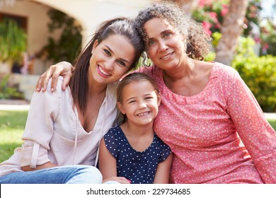 Grandmother In Garden With Daughter And Granddaughter
