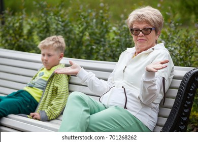 Grandmother gives her hands after unpleasant conversation to her grandson