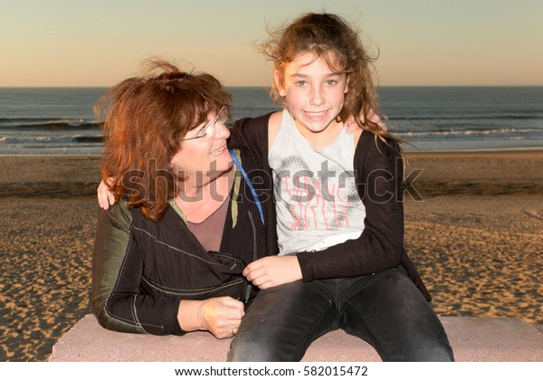 Grandmother with the grand daughter at the beach on summer