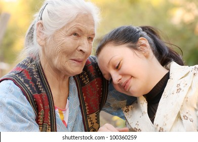 The grandmother with the grand daughter. A photo on outdoors
