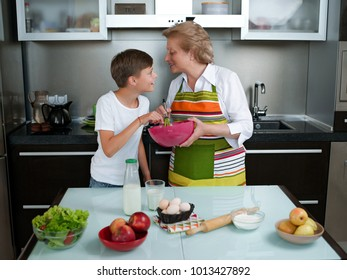 Grandmother with grandchild baking cookies prepare dough