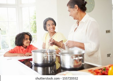 Grandmother And Grandchildren Cooking Meal At Home